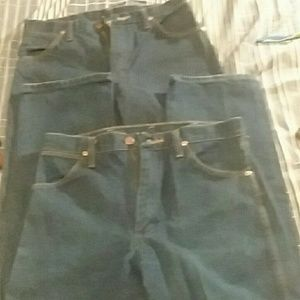 2 Pairs of boot cut wrangler jeans 5 pocket. Used